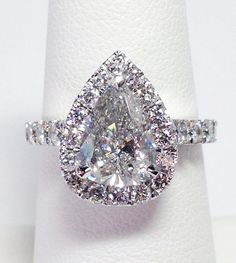 Up for sale is a Beautiful 14K White Gold Pear Shape Diamond Halo Modern Style Band Can Be Worn As A Engagement Ring, Wedding Band, Anniversary Ring, Right Hand Ring, and Is Great For Any Occasion Birthday, Christmas, Valentines Day, Push Gift. Diamond Total Weight 1.75 Carats Color: F