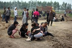 Family mourn loved ones lost in a Poultry Plant fire in Northeast China.