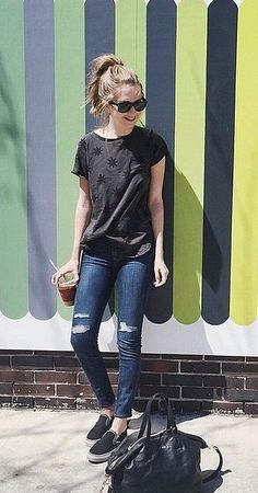 A Black T-Shirt, Jeans, and Black Slip-On Sneakers