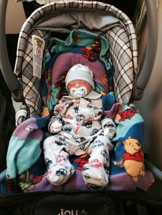 Isaiah chillin in his car seat !