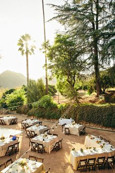 Dinner set up on the tennis court at Lily & Scott's Ojai Ranch Wedding | Sweet Little Photographs