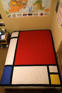 Another pinner says: I made this Piet Mondrian quilt as an anniversary gift for my boyfriend, who is a big Mondrian fan. (DIY, art, art quilt) לניר, כשנחליף מיטה