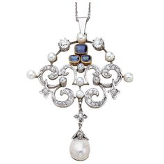 A platinum pendant with diamonds, sapphires and pearls. The pendant contains three square cut sapphires set in gold, surrounded by fifty early cut diamonds, seven 8 1/2mm pearls and a baroque and diamond pearl drop. Hallmarked on the bale. C. 1910