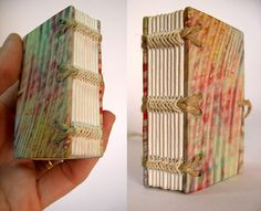 Handbound book by Zoopress studio/Rosa Guimarães. Cover on Japanese paper hand-painted on pith paper Arches MBM, and sewing with ropes and natural linen thread.