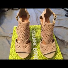 Gianni Bini Sierra Tan wedge sandals Tan comfortable wedge sandal. Minor stain from dye of blue jeans on the front of the sandals as shown in picture. Side buckle and studded In the back. Perfect shoe for the summer and spring. Gianni Bini Shoes Wedges