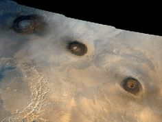 Tharsis Montes - Volcanic Mountains on Mars - These three volcanic mountains in the Tharsis Region of Mars are all about 10 miles (16.09 km) high, but their summits are at about the same elevation as Olympus Mons (14 miles / 22.53 km high) because these three sit on a greatly uplifted chunk of the Mars crust - from left : Arsia Mons, Pavonis Mons & Ascraeus Mons