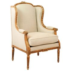 Gilded Louis XVI Wingback Armchair   From a unique collection of antique and modern armchairs at https://www.1stdibs.com/furniture/seating/armchairs/