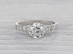 Antique Edwardian engagement ring made in platinum and centered with an EGL certified approximately 1.20 carat old European cut diamond with H-I color and VS1 clarity. Signed Tiffany & Co. Circa 1915.