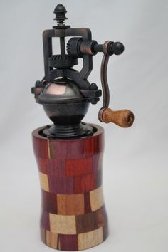 "This peppermill has an antique-style peppermill mechanism that adjusts easily from coarse to extra fine. The metal is an Antique Brass finish. It does not accommodate salt since it is metal. The body of the mill contains 60 pieces of exotic woods. It is approx. 2.5""dia. x 8""H. Cards for the Care of Wood and the names of all the woods and origin are sent with the purchase. # 617  0816"