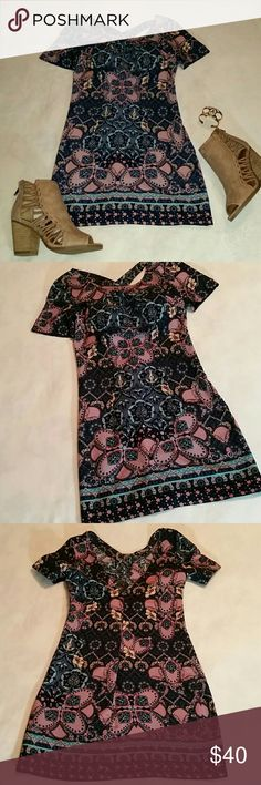 """HOLLISTER BOHO PRINT SHIFT DRESS CROSS STRAP BACK Gorgeous Hollister boho print, short sleeved, shift dress. Has cross straps in back and hidden zipper on side. I stuck a piece of paper in back top show cross straps :) The floral and paisley print on this dress is so pretty! The colors include navy blue, peach, yellow, and turquoise.  Size XS ( juniors ) Armpit to armpit 16"""" across laying flat  Shoulder to hem 31.5"""" Hollister Dresses Mini"""