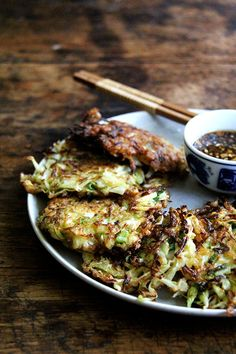 cabbage pancakes with soy dipping sauce, a healthy appetizer or light meal made with just a bit of flour and lots of cabbage!