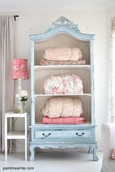 Cheap broken armoire- take off doors an pain. Use as book shelf. Great colors!