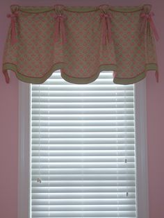 Pleated valance with contrast banding and button and ribbon embellishment.
