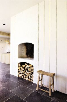 Fireplace in AM Projects private home from Belgium, love the height of the fireplace with the wood stored underneath
