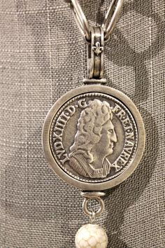 """Created to celebrate King Louis XIV, this medallion states """"good taste remains French."""" It replicates a Louis XIV bust -- created in 1644 and comes from the Excella coffee company."""
