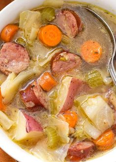 Instant Pot Kielbasa Cabbage Potato Soup is a Fall soup if ever there was one! This simple and rustic soup has a rich broth and chunky carrots, green cabbage, and tasty smoked kielbasa. This pressure cooker Kielbasa Cabbage Potato Soup recipe is one of my Keilbasa And Cabbage, Cabbage Potato Soup, Cabbage And Potatoes, Cabbage And Sausage, Cabbage Soup Recipes, Potato Recipes, Kielbasa And Potatoes, Cabbage Stew, Cabbage And Carrots Recipe