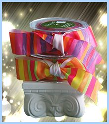 """A grosgrain vertical stripe ribbon that says Fiesta or Party. The ribbon measures 1 1/2"""" wide with 25 yards on a roll. It is not available in any other widths. $39.95 per roll. Order this ribbon for decoration on your wedding welcome bag or wedding favors. With all the bright colors you can accent with a rainbow of tissue papers. See more packaging ideas at www.favorsyoukeep.com. Questions? Need ribbon in a rush? Call the ribbonistas at 512.323.0600"""