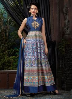 Make the heads flip whenever you dress up with this stunning blue banglori silk designer gown. The fantastic attire creates a dramatic canvas with incredible digital print and embroidered work