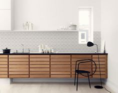 An Alternative Kitchen Splashback - Kitchen Wallpaper by Lime Lace | An innovative wall covering that is not only waterproof its heat proof too. Great for rentals as its easily removed.