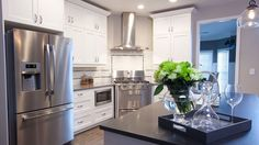 One of my favourite episoldes! Love the angled stove and tiling. I feel like repainting my kitchen cupboards white...right now. Property Brothers   W Network   Luca Anne & Barbara   Episode 8 Season 4