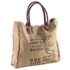 he Vintage Ink Stamp weekender is stylish and versatile. This up-cycled canvas bag can handle just about anything. It features a natural khaki color with graphi