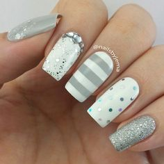 Stripes with rhinestone glitter decorated nails