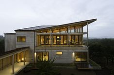 Oregon Coast residence. I love the covered walkway and roof line.  by Boora Architects