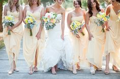 Bridesmaids in sunny yellow maxi dresses for the wedding day
