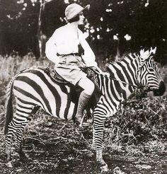 American travel documentary filmmaker Osa Johnson on a zebra in Kenya, ca. 1930