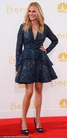 Bucking the trend: Julia Roberts went for a navy Elie Saab short dress that featured bejeweled detail