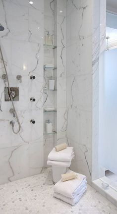 hex tile on shower floor (yours would be larger though), larger format tile on walls, and glass shelves in niche #GlassShelves