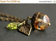 VALENTINE SALE Acorn Necklace. Frost & Fawn Acorn Pendant. Glass Acorn Necklace. Bronze Acorn Charm Necklace. Acorn Jewelry. Handmade Jewelr by StumblingOnSainthood from Stumbling On Sainthood. Find it now at http://ift.tt/2nMr9Jt!