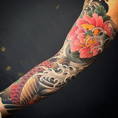 Japanese tattoo sleeve by @mattbeckerich. #japaneseink #japanesetattoo #irezumi #tebori #colortattoo #colorfultattoo #cooltattoo #largetattoo #armtattoo #flowertattoo #peonytattoo #fishtattoo #koitattoo #wavetattoo #naturetattoo
