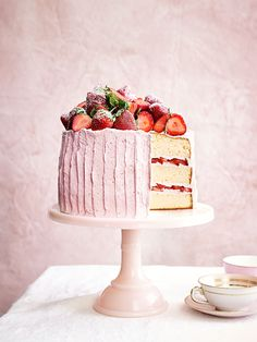 Delightfully light, airy, and ideal for any spring or summer soiree, this pink perfection boasts three layers of sponge cake, three whole pounds of fresh berries, and a delightful whipped frosting.