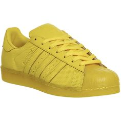 Adidas Superstar 1 (120 BAM) ❤ liked on Polyvore featuring shoes, trainers, unisex sports, yellow, low profile shoes, yellow shoes, low top, sports shoes and striped shoes
