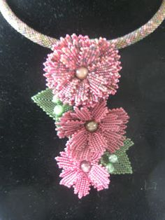 Sweet flowers here by beadman.  I would love a class on this design.