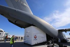 Personnel supporting NASA's InSight mission to Mars load the crated InSight spacecraft into a C-17 cargo aircraft