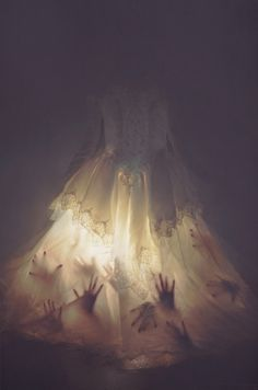 Here's a creepy Halloween costume idea: Find an old wedding dress at goodwill, tape hand cut outs in it and shine a… Halloween Prop, Casa Halloween, Holidays Halloween, Halloween 2016, Happy Halloween, Creepy Halloween Decorations, Scary Halloween Costumes, Halloween Haunted Houses, Halloween Dress