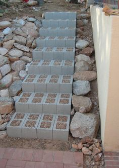 Outdoors steps on hillside - top with stones or bricks
