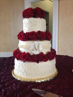 Red rose and Gold accent buttercream wedding cake.  Wedding cake delivered to The Italian Club in Tampa Florida