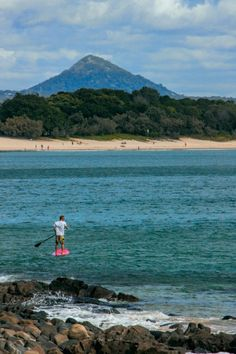 Australia has some great short break locations in every state.  How about stand up paddle boarding in Noosa, Queensland with a backdrop to the Glasshouse Mountains