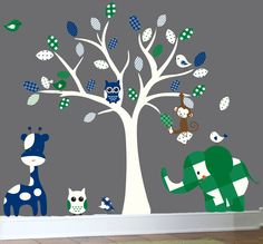 Jungle wall decal - nursery white tree wall decal - green patterned elephant, blue giraffe wall sticker. $129.00, via Etsy.