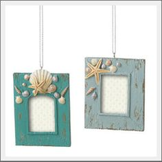 Beach Cottage photo frame ornament. Relive and share your beach vacation on the Christmas tree. Photo frame ornament is hand-painted and distressed for a beach cottage style with sea shell accents.  Write the date on the bottom of the frame or place a new picture within each year.