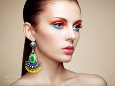 Portrait of beautiful young woman with earring. Jewelry and acce by heckmannoleg