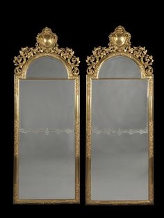 A Very Fine Pair of Tall English Giltwood Mirrors  English, Circa 1880.