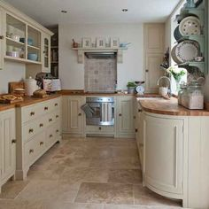 Painted kitchen with limestone floor http www for High level kitchen units