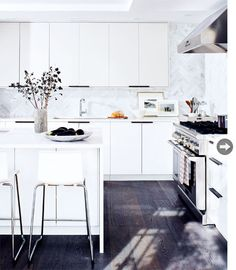 herringbone marble tile + IKEA high-gloss cabinets + bronze handles + quartz countertop