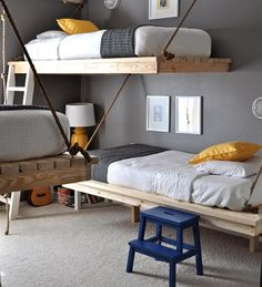I'm completely charmed by this bedroom! What do you think of the hanging beds? I think they're ingenious and want to copy them. I like the navy and yellow color scheme as well. (If you're worried, know that each bed is bolted securely to the wall.) You can read all about how the room came to be, and see lots more photos at The Bumper Crop.