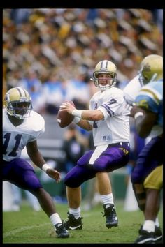 Quarterback Damon Huard of the Washington Huskies looks to pass the ball during a game against the UCLA Bruins at the Rose Bowl in Pasadena...