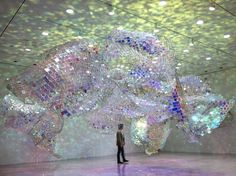 """""""Unwoven Light is made up of 37 individual units composed of chain link fencing that is arranged into a sculptural form that's all about light."""""""